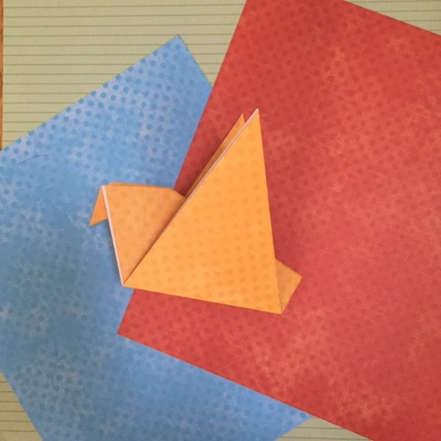 Paper folding to make and easy origami bird.