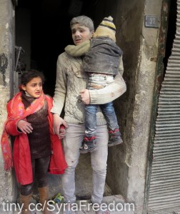 Children exit a building after an alleged air strike by Syrian government forces on the northern Syrian city of Aleppo on February 3, 2014., foto: Freedom House