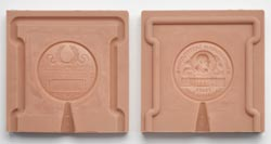 Both halves of the Freer Medal mould.