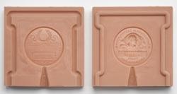 Both halves of the Freer Medal mould.