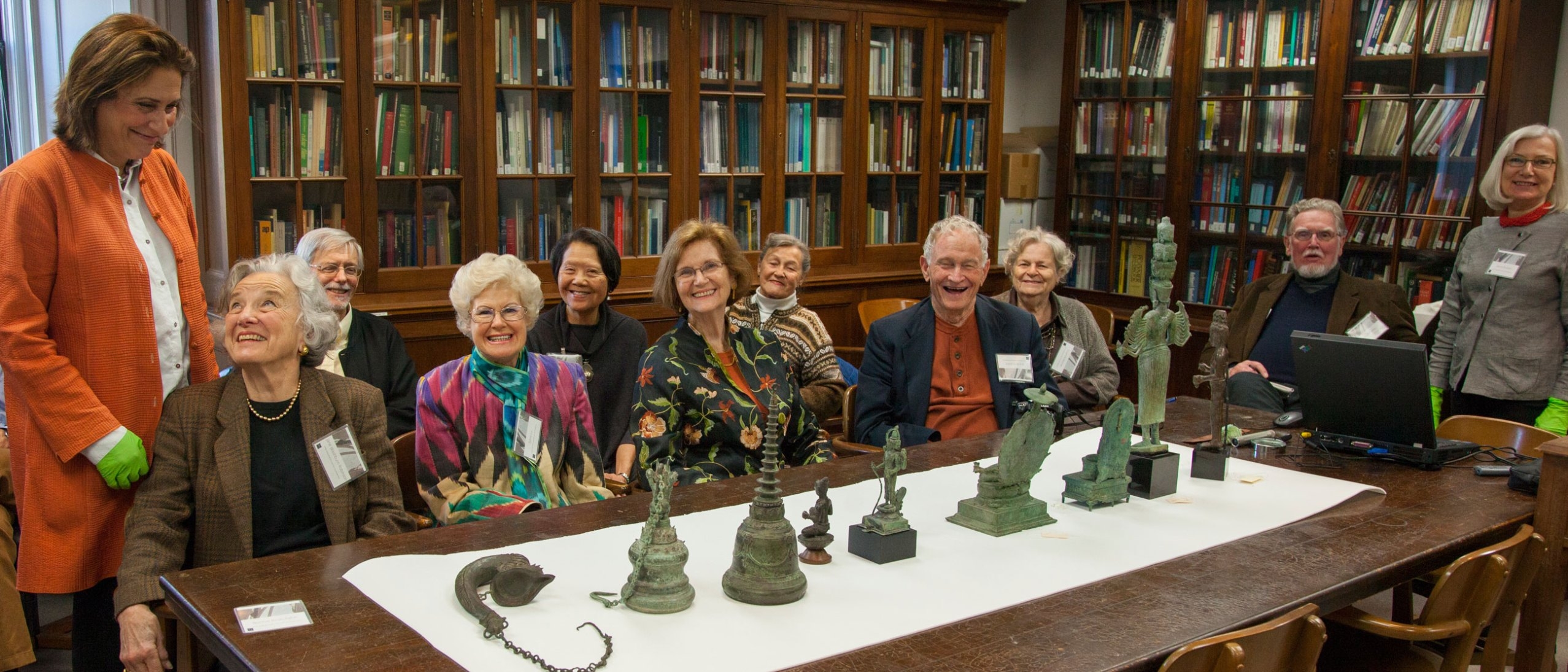 indian art curator Debra Diamond, head of conservation Donna Strahan, and the Friends in the FS Conservation library examining an array of sculpture