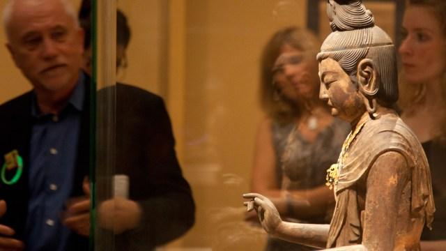 Japanese art curator James Ulak giving an exhibition tour