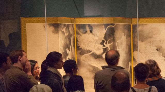 "Crowd of guests viewing Sotatsu's ""Dragons and Clouds"" screen painting."