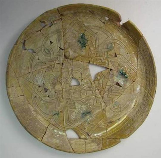 Dish F1957.23 during treatment: after reassembly of the sherds.