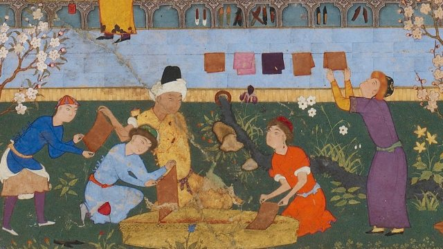 Scene depicts a master disciplining a youth, a group of students copying texts, craftsmen making paper, and several men cooking by an open fire