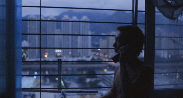 Man looking out at Hong Kong