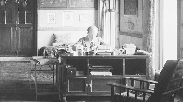 Ernst Herzfeld at his desk at home, archival image