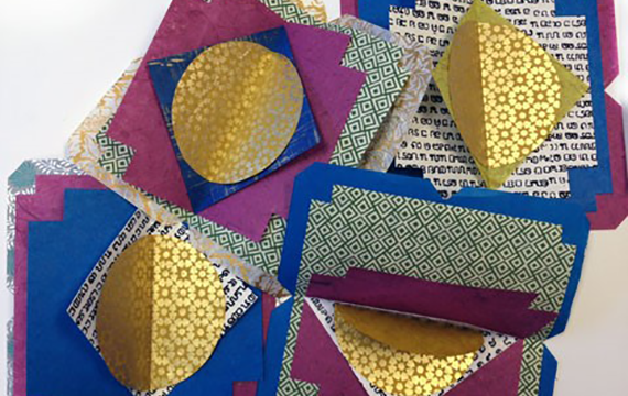 Colorful and patterned paper cut into different shapes, glued together.