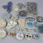 Colorful fragments of ceramics laid out on a table