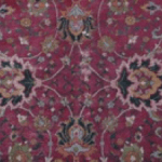 Detail of wine-colored carpet with floral motif