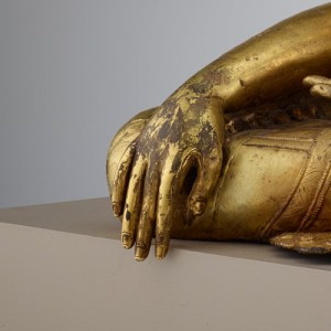 detail, showing hand of sculpture touching the ground
