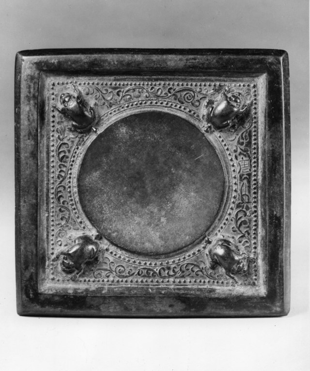 Photo of Bronze square mirror. Tang dynasty, 8th century., H: 13.5 cm. (5 3/8 in.). Singer catalogue number: [1398].