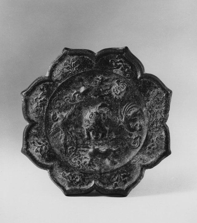 Photo of Bronze mirror. Tang dynasty, 8th century., Diam: 15.6 cm. (6 1/8 in.). Singer catalogue number: [1404].