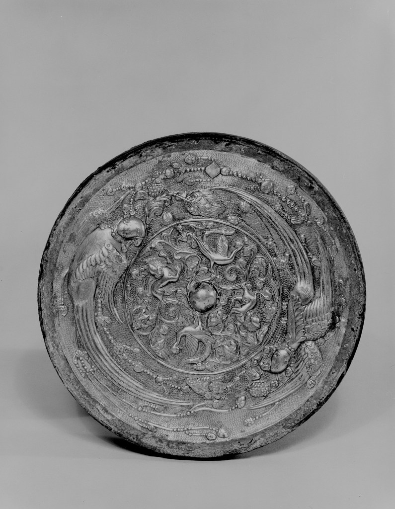 Photo of Bronze mirror with gilt silver back. Tang dynasty, 8th century., Diam: 17.9 cm. (7 in.). Singer catalogue number: [1407].