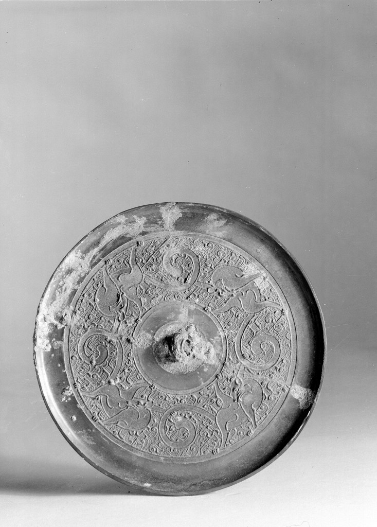 Photo, Bronze mirror. Eastern Zhou dynasty, 5th–3rd century BCE., Diam: 16.8 cm. (6 5/8 in.) Singer catalogue number: [618].