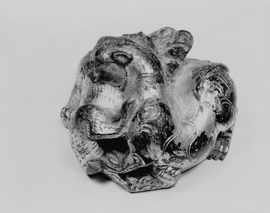Photo, Gilt bronze weight. Eastern Han dynasty, 1st–3rd century CE., Diam: 6.5 cm. (2 1/2 in.) Singer catalogue number: [982].