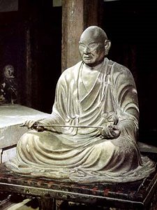 seated sculpture of a monk