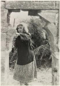 Elizabeth Moynihan studying a stone archway in Dholpur.
