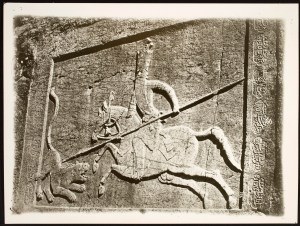 Rock cut relief depicting Fath Ali Shah on horseback, fighting a lion with a spear.