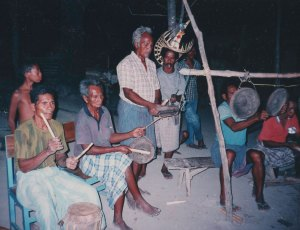 Men playing drums and gongs.