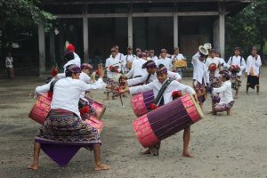 Gendang beleq performers outside, beating on huge, colorful drums.