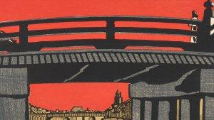 print of grey bridge against deep red background