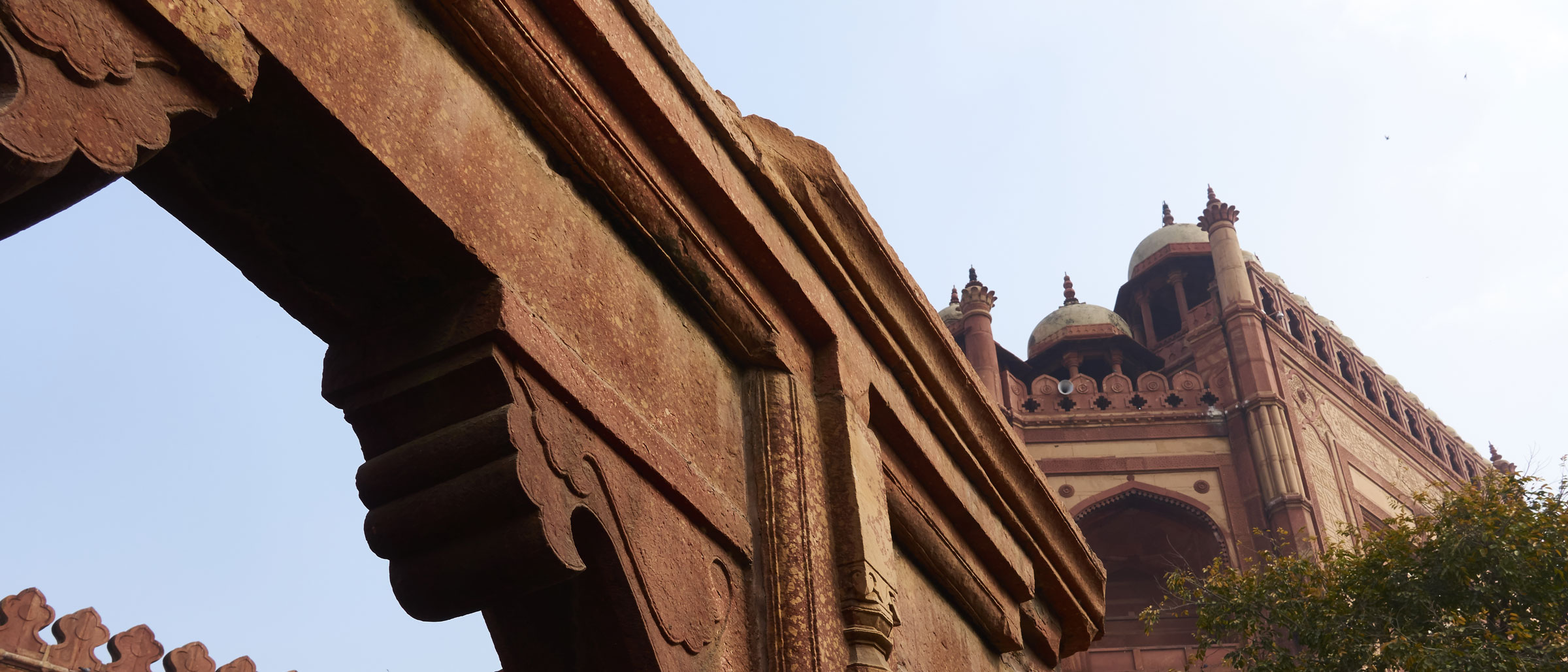 Stone archways against a light blue sky