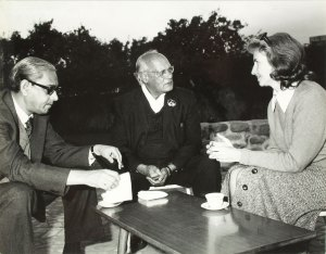 Elizabeth Moynihan meeting with Dr. M.S. Randhawa and another gentleman around a table.