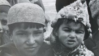 Village boys wearing Central Asian hats