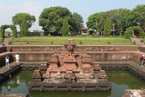 Brick temple in a below-groundlevel pool