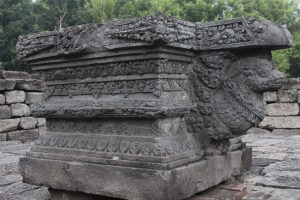 Elaborately carved stone linga pedestal supported by a serpent