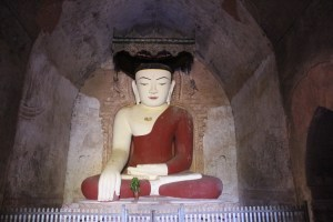 Large seated earth-touching gesture Buddha in a niche