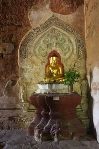 Small seated gilt earth-touching gesture Buddha on a pedestal