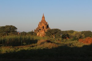 At sunrise, a tall stupa in the landscape