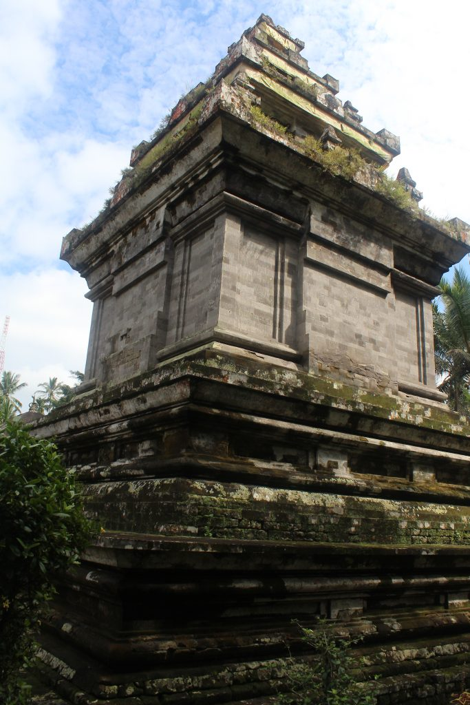 Well restored structural temple with overgrown base