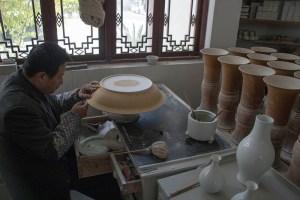 Man working on an unglazed bowl