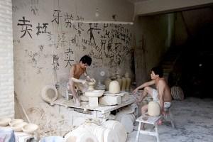 Men at a pottery wheel