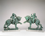 Pair of lions with riders