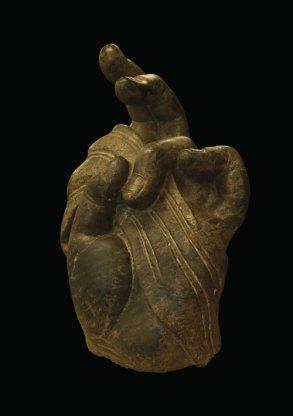 Detached stone hand in mudra