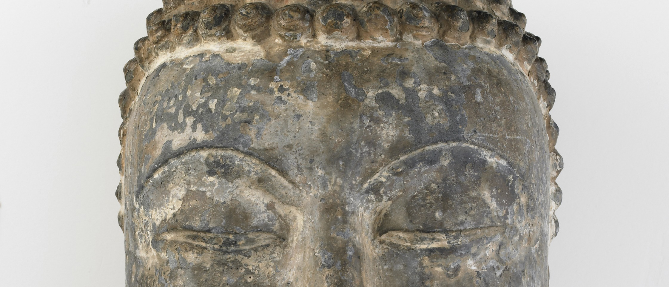 Eyes of a stone buddha sculpture