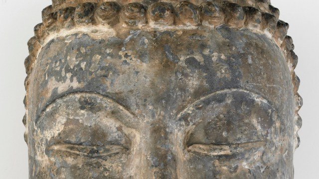 Eyes of a stone buddha sculpture