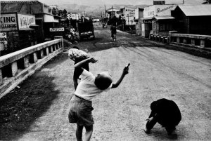 black and white photo of three kids miming a battle