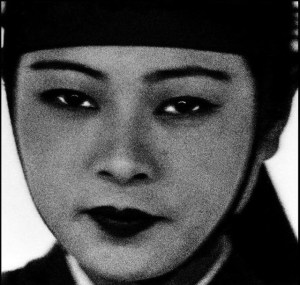 a black and white photo of a made up face
