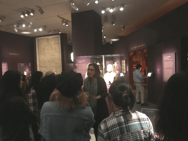"Curator Debra Diamond meets with members of the Teen Council in ""Encountering the Buddha."""
