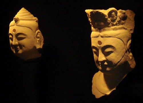 Bright yellow printed plastic replicas of statue heads
