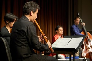 Members of the Silkroad ensemble playing their instruments.