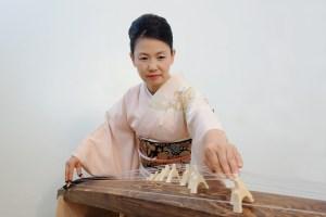 Masayo Ishigure playing the traditional 13-string koto.