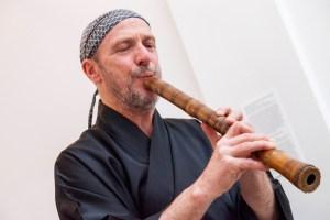 John Kaizan Neptune playing the shakuhachi bamboo flute.