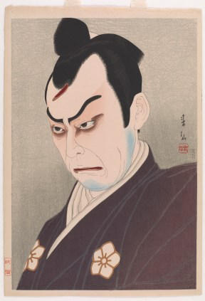 man with exaggerated eyebrows making a scowling face