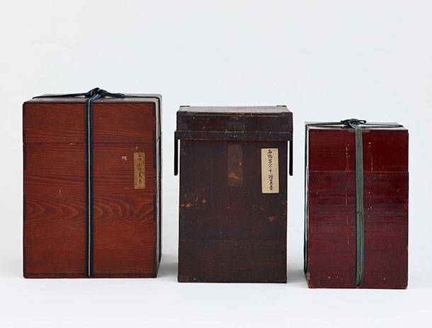 Three nesting lacquer boxes, arranged by height with the largest, outer-most box on the left.